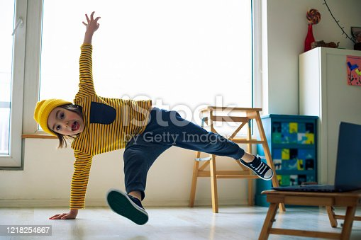 Little boy dancing break at home. Home Pleasures. Handstand. Illness prevention. Quarantine.
