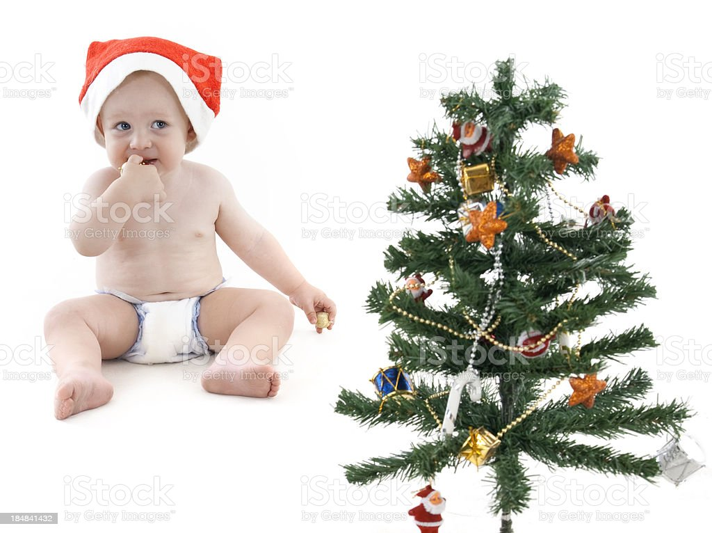 Little Boy Decorating Christmas Tree royalty-free stock photo