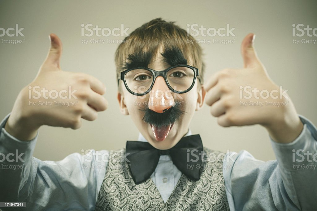 Little Boy Disguised as Groucho Marx with Glasses stock photo