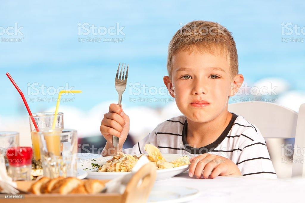 Little Boy Disliking His Food royalty-free stock photo