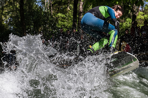 Little boy doing a 360 on the Wave Eisbach
