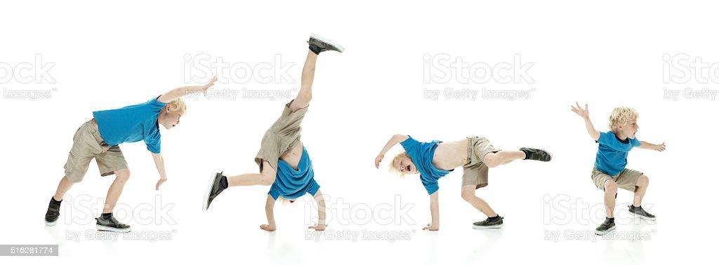 Little boy doing cartwheel stock photo