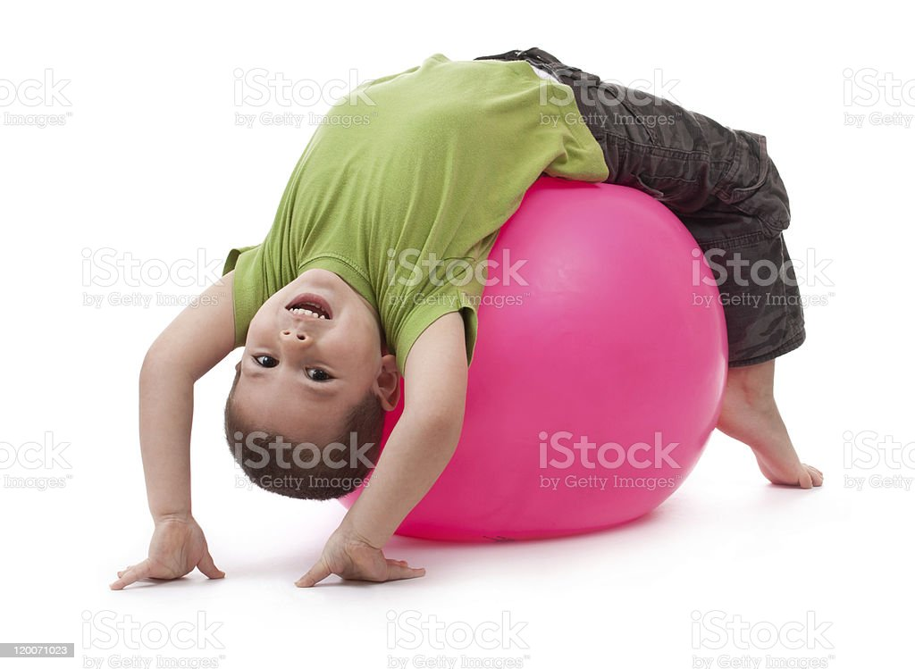Little boy doing gymnastic exercises stock photo