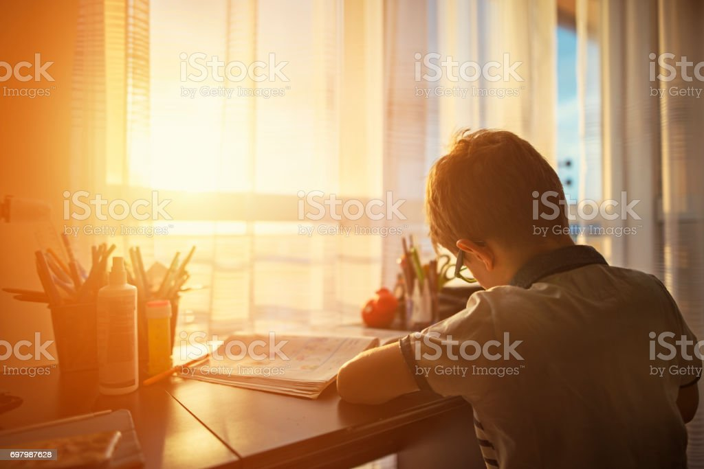 Little boy doing homework at home stock photo