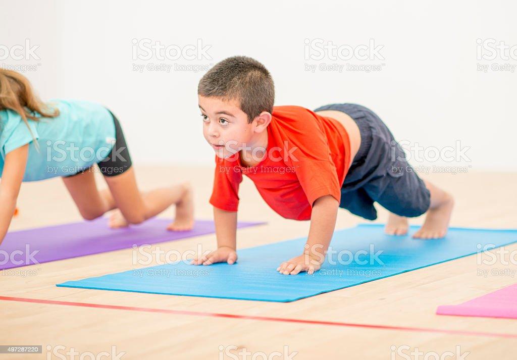 Little Boy Doing Yoga stock photo