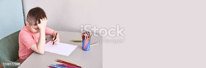 istock Little boy drawing. Closed Locking Exercise. Homemade routine. School lessons 1249177398