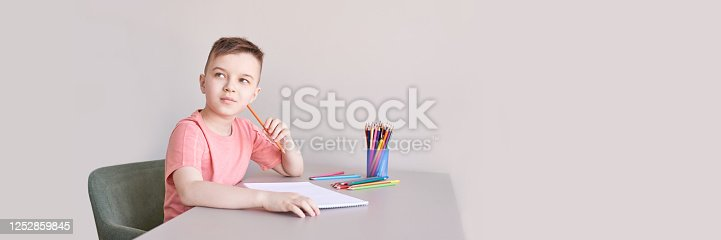 istock Little boy drawing. Closed Locking Exercise. Homemade routine. School lessons 1252859845