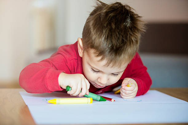 Little boy drawing stock photo