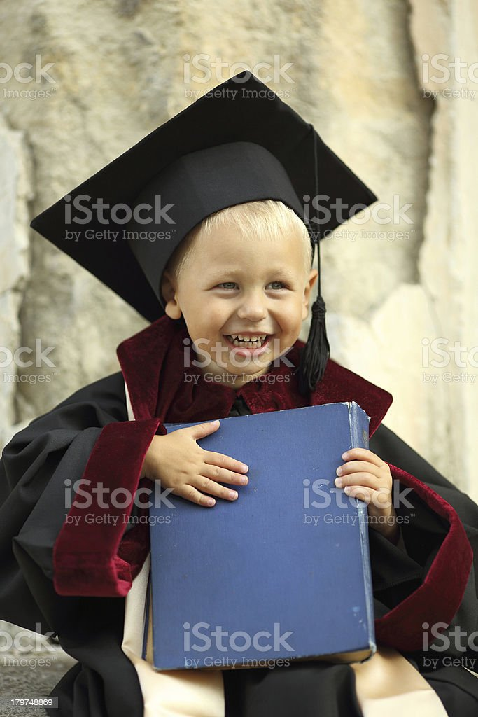 little boy dressed as a graduate royalty-free stock photo