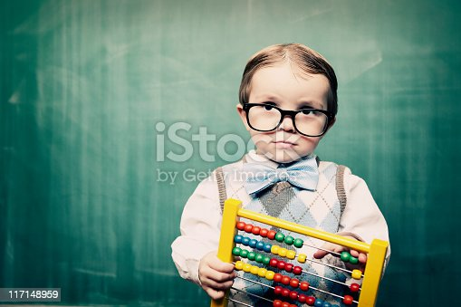 istock Little Boy Dressed as Acccountant using Abacus 117148959