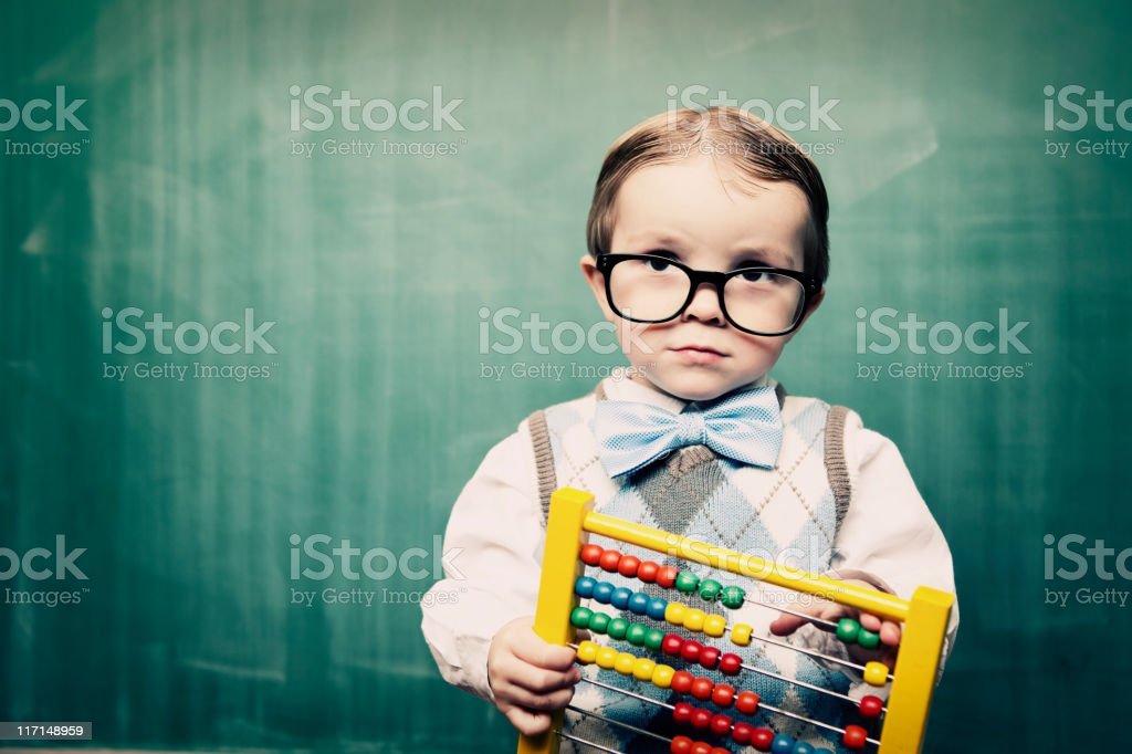Little Boy Dressed as Acccountant using Abacus stock photo
