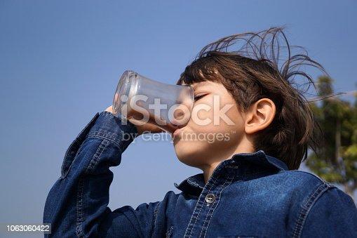 Little boy drinking chocolate milk