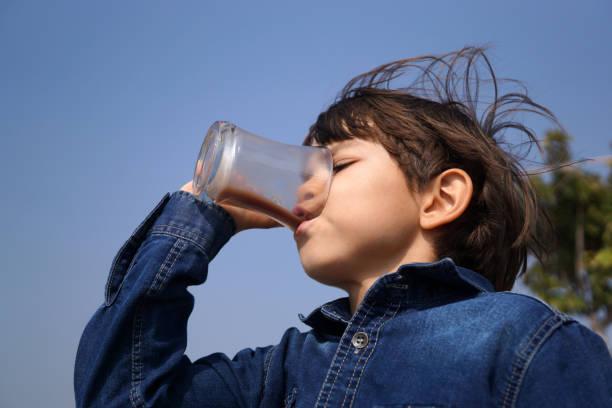 Little boy drinking chocolate milk Little boy drinking chocolate milk chocolate milk stock pictures, royalty-free photos & images