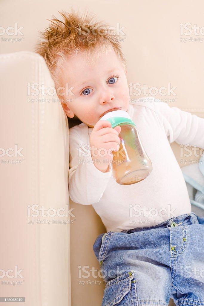 Little boy drinking royalty-free stock photo