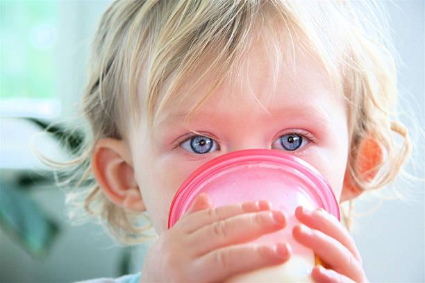 Little Boy Drinking stock photo