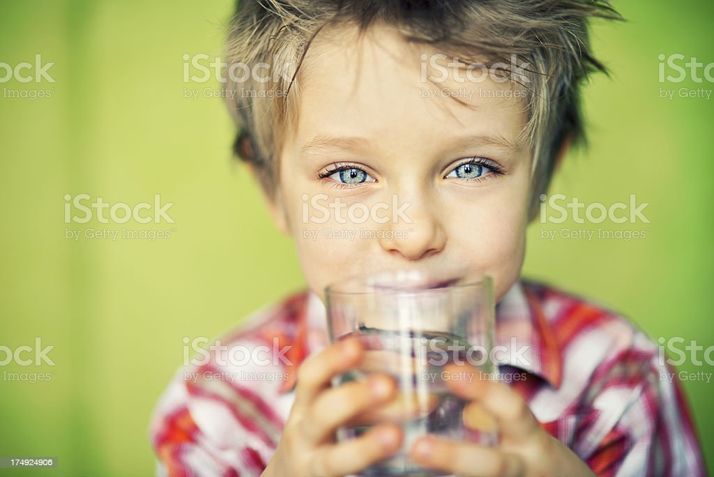 Little boy drinking water stock photo