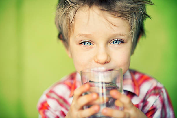little boy drinking water - drinking water stock photos and pictures