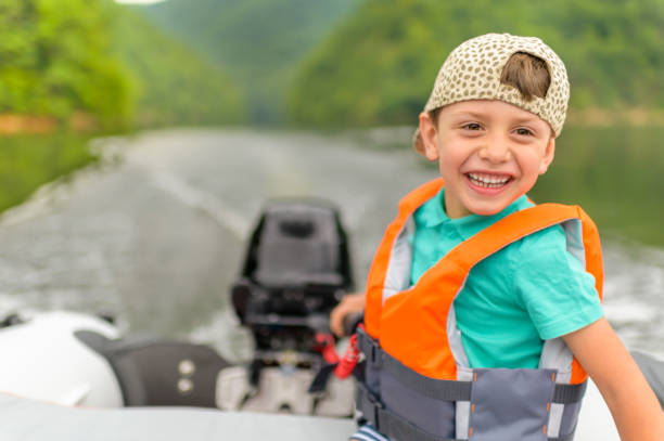 Little Boy Driving the Motorboat stock photo