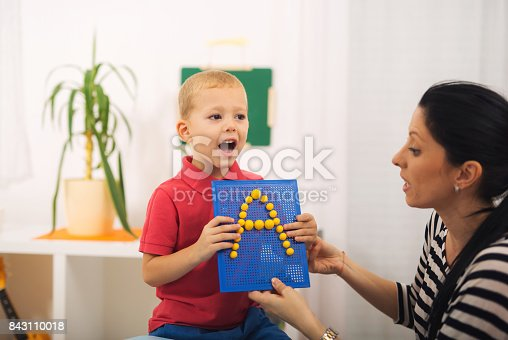 istock Little boy during lesson with his speech therapist 843110018