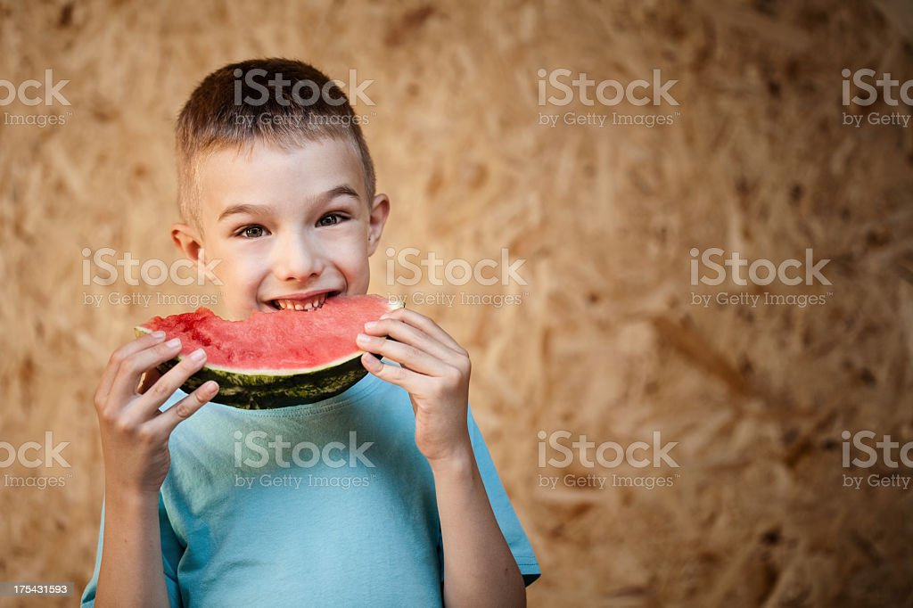 Little boy eating a watermellon royalty-free stock photo