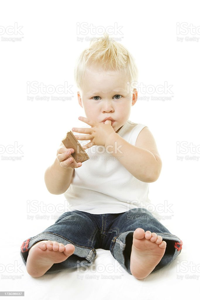 Little Boy eating Chocolate Bar royalty-free stock photo