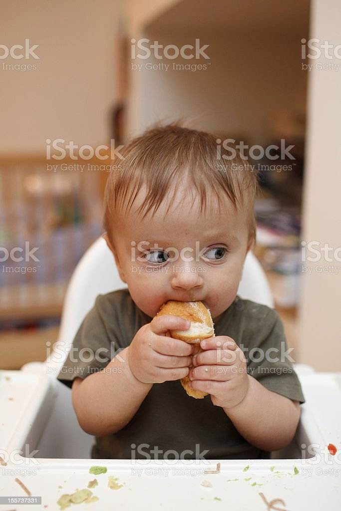 Little boy eating dinner stock photo