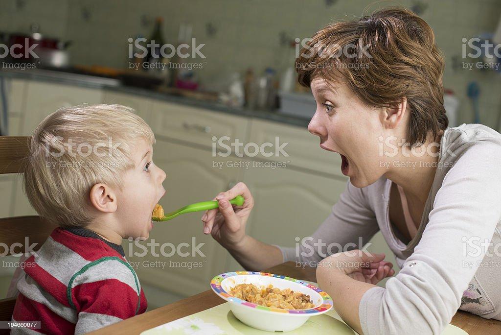 Little boy eating his dinner stock photo