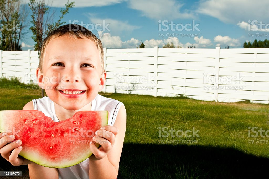 Little Boy Eating Watermelon royalty-free stock photo