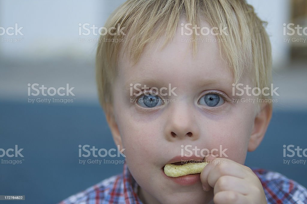 Little Boy Eats Snack at the Park royalty-free stock photo