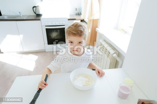 488109116 istock photo little boy enjoy cooking in kitchen interior 1130695562