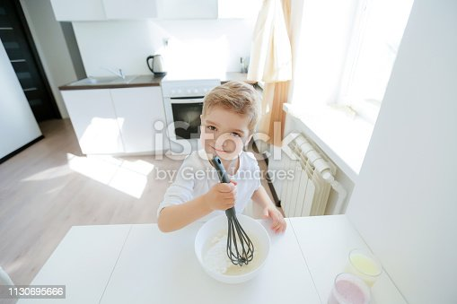 488109116 istock photo little boy enjoy cooking in kitchen interior 1130695666