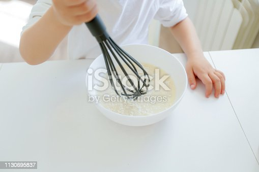 488109116 istock photo little boy enjoy cooking in kitchen interior 1130695837