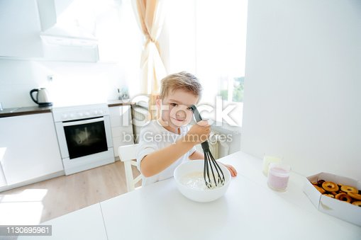 488109116 istock photo little boy enjoy cooking in kitchen interior 1130695961