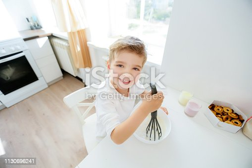 488109116 istock photo little boy enjoy cooking in kitchen interior 1130696241