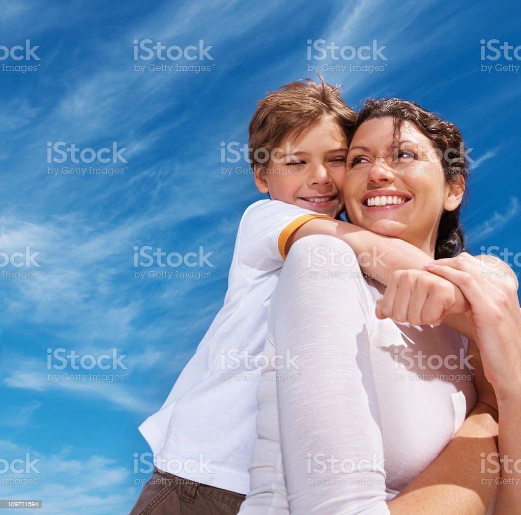Little boy enjoying a piggyback ride outdoors royalty-free stock photo