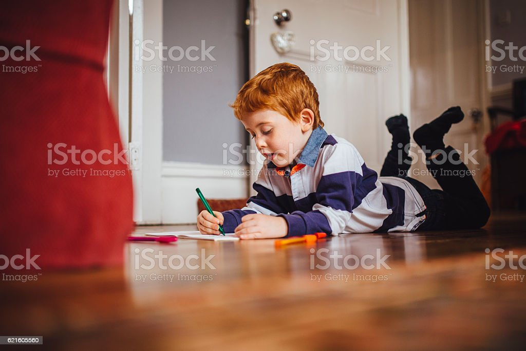 Little Boy Enjoying Writing at Home stock photo