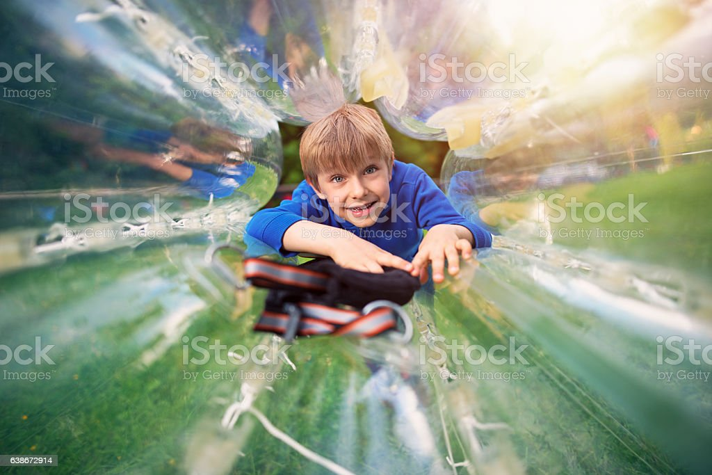 Little boy entering inside a zorb sphere stock photo