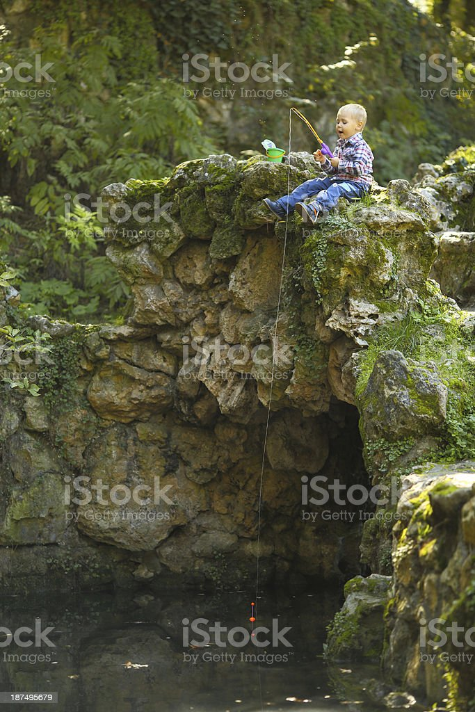 little boy fishing royalty-free stock photo