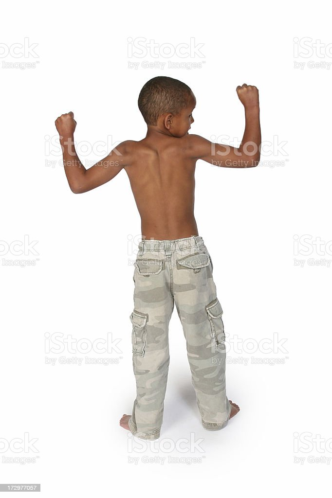 Little boy flexing stock photo