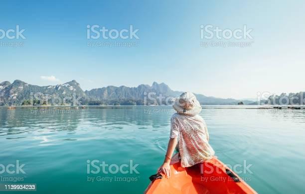 Photo of Little boy floating on kayak on Cheow Lan Lake, Khao Sok national park, Thailand