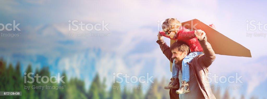 Little Boy Flying in a Cardboard Plane stock photo