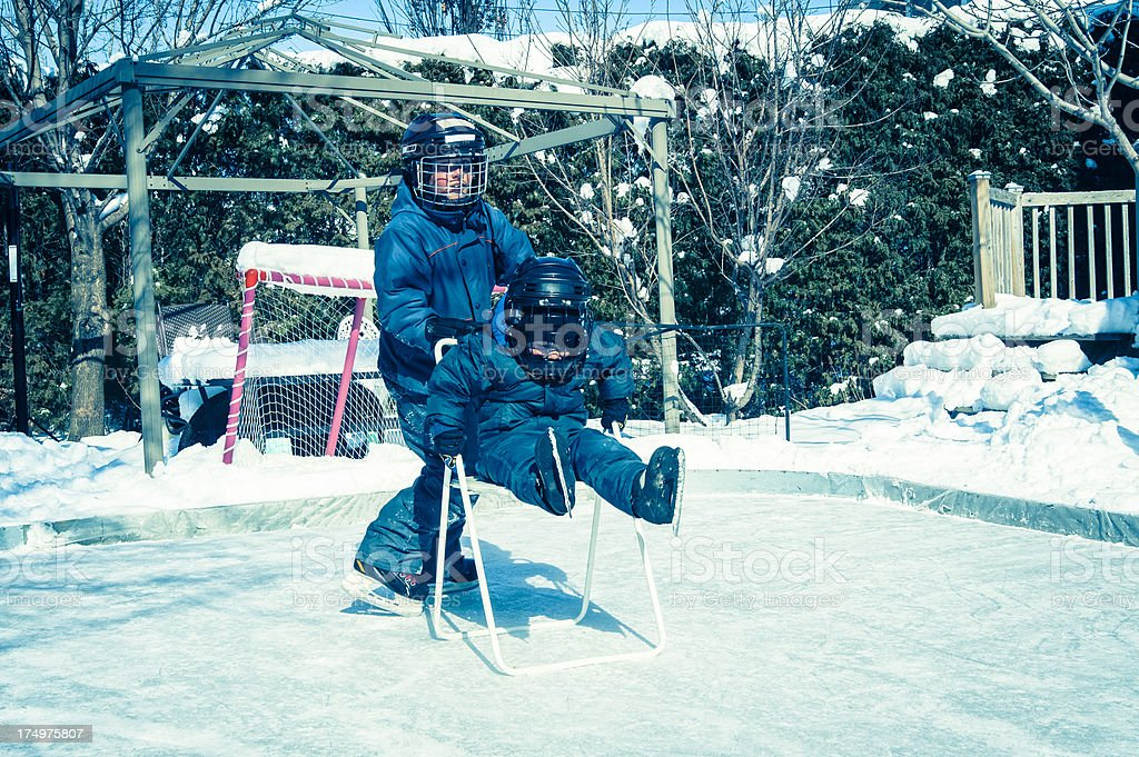 Little boy found a faster way to skate. royalty-free stock photo