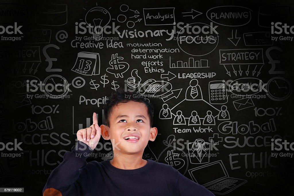 Little Boy Get a Business Idea stock photo