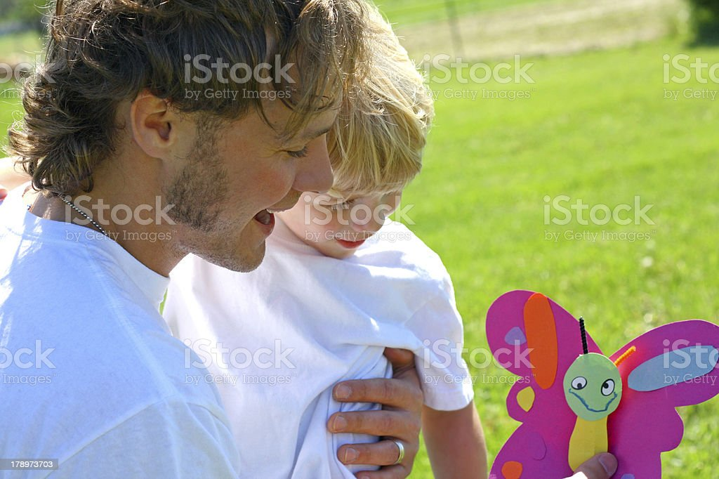 Little Boy Giving Dad a Father's Day Card royalty-free stock photo