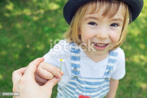 istock Little boy giving flower to mom 936658456
