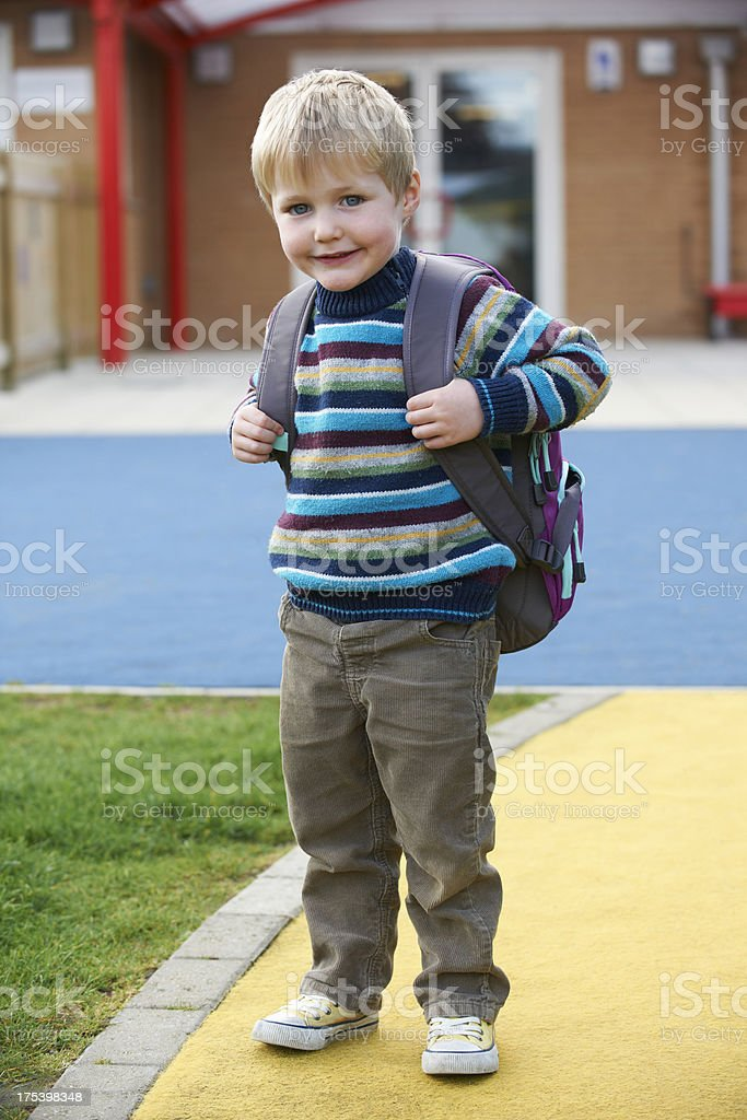 Little Boy Going To School Wearing Backpack stock photo