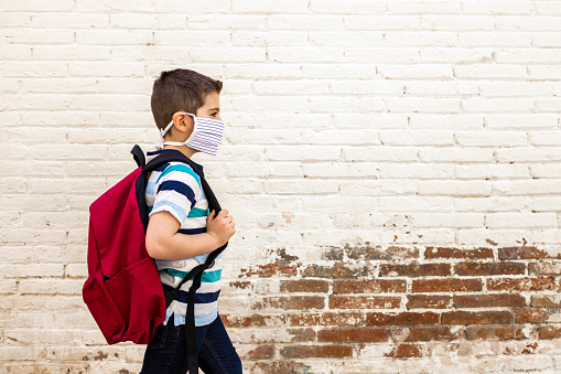 Little Boy Going To School With Protective Mask Stock Photo - Download Image Now
