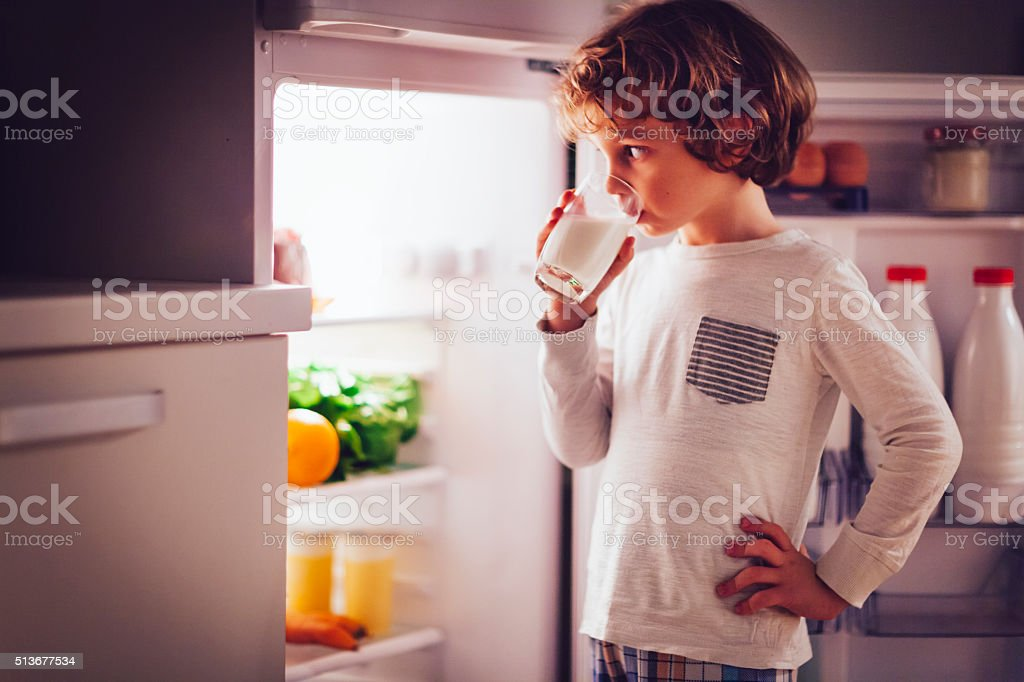 Little boy having a glass of milk royalty-free stock photo
