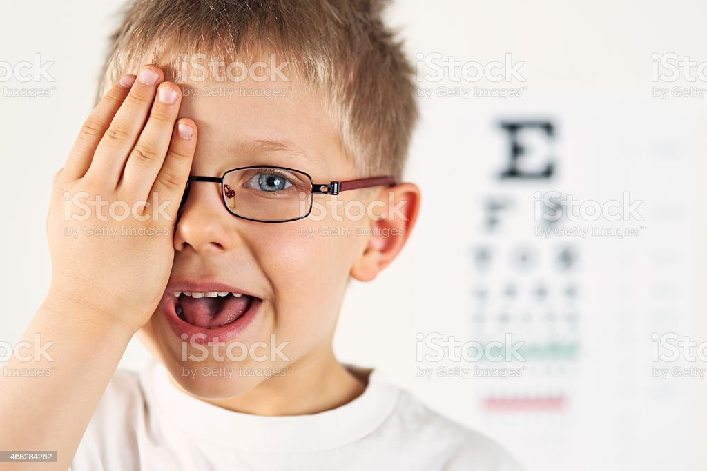 Little boy having eye exam. stock photo