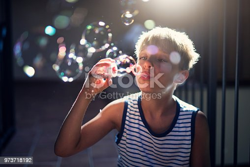 Little boy playing with bubbles. Nikon D810